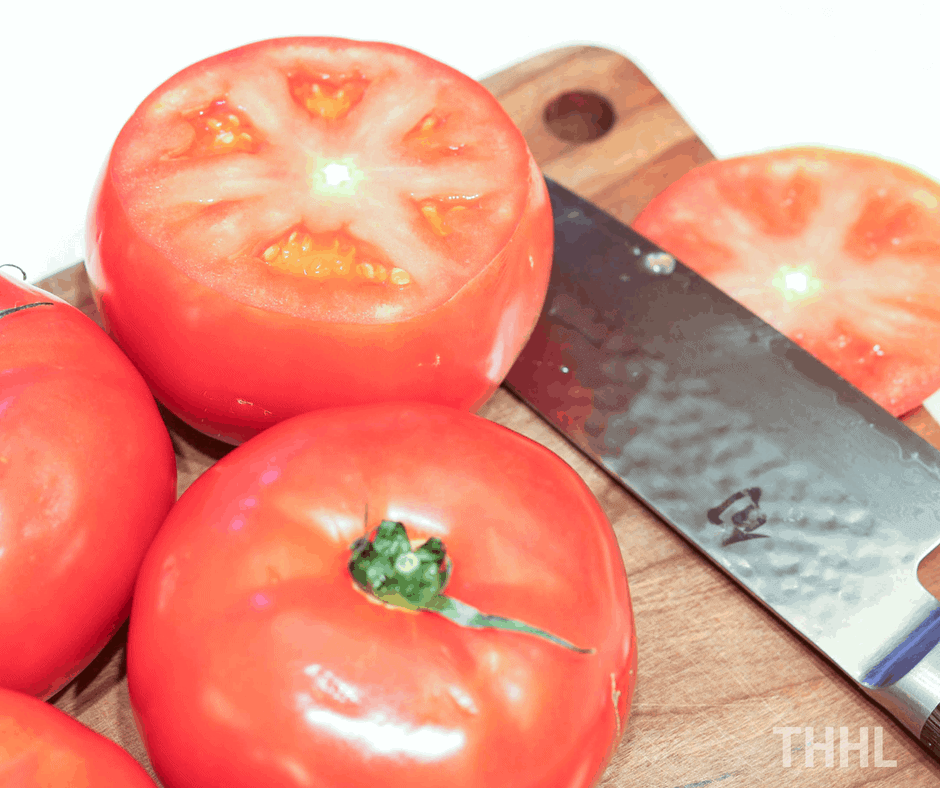 Keto Tuna Melt Stuffed Tomatoes - Cutting tomatoes' tops