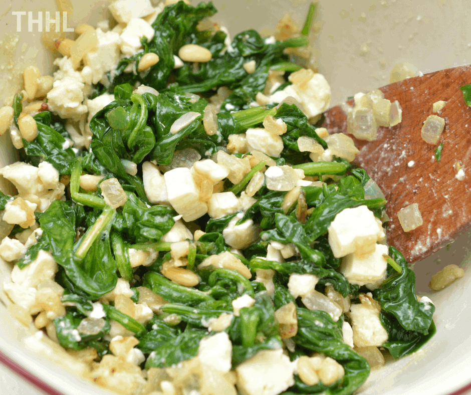 mixing with spinach and feta
